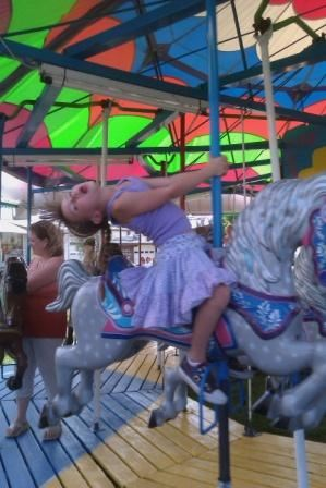 Little Girl on a Merry-Go-Round